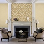 Armchairs and lamps at fireplace in living room in Shelley Morris Designed Colonial style residence in New Canaan, Connecticut, USA